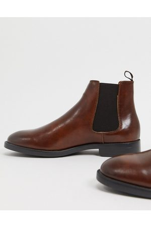ASOS Chelsea boots in faux leather with black sole