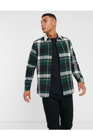 ASOS Brushed flannel check overshirt in tartan with borg collar