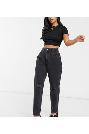 ASOS ASOS DESIGN Petite high rise 'slouchy' mom jeans in washed with rips