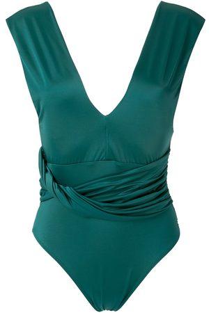 Brigitte Tania draped one-piece