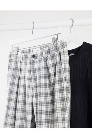 Topman Tapered trousers in black & white check