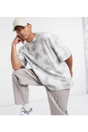 COLLUSION Oversized t-shirt with logo print in tie dye pique