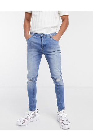 ASOS Spray on jeans with power stretch in mid wash with rips