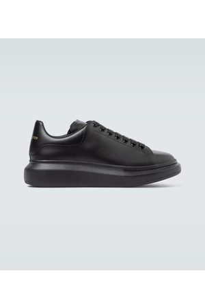 Alexander McQueen Oversized leather and velour sneakers