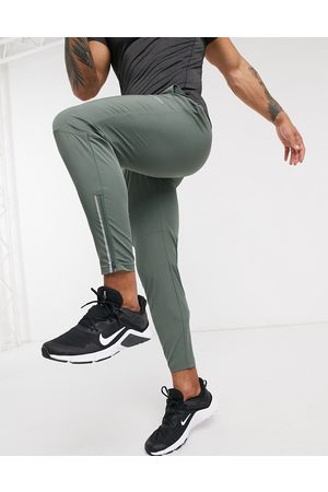 ASOS Woven skinny tapered running joggers with reflective zip detail in khaki