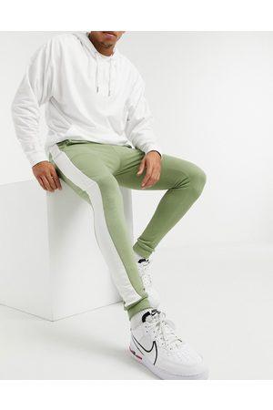ASOS Skinny joggers with side stripe in khaki
