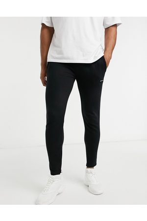 Good For Nothing Essentials joggers with rubber logo in