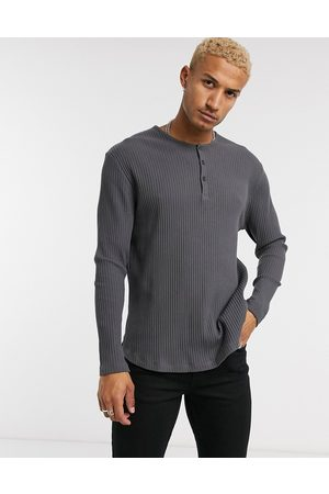 ASOS Relaxed long sleeve rib t-shirt in washed black