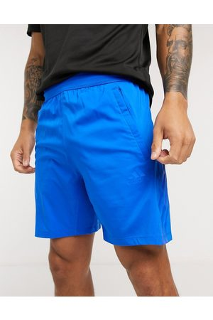 adidas Training tonal stripe shorts in