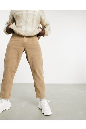 ASOS Relaxed tapered corduroy jeans in light