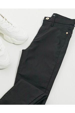 River Island High rise waxed skinny jeans in