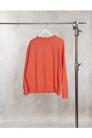 ASOS DESIGN Super oversized cocoon sweatshirt with panel detail in coral
