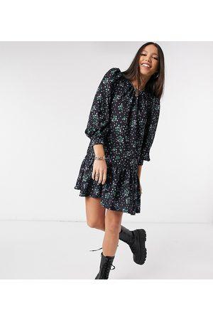 ASOS ASOS DESIGN Tall mini pep hem volume sleeve smock dress in black and blue floral