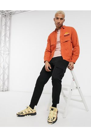 ASOS Twill overshirt in orange with sunset chest embroidery
