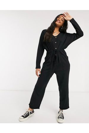 ASOS DESIGN Lounge jersey button front long sleeve tie waist jumpsuit in