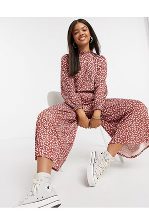 ASOS DESIGN Long sleeve floral frill neck jumpsuit in red-Multi