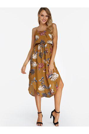 YOINS Random Floral Print Sleeveless Blackless Stretch Waist Slit Hem Dress