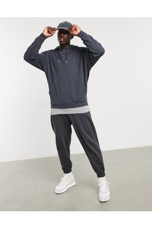 ASOS Oversized hoodie in washed with grey t-shirt hem