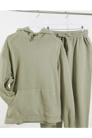ASOS Oversized tracksuit with hoodie & super oversized joggers in washed green