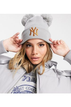 New Era Exclusive double pom beanie in with rose gold NY
