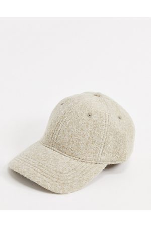 ASOS Textured baseball cap in off