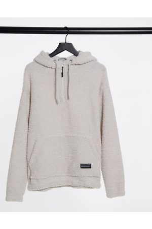 ASOS Oversized hoodie in off- teddy borg with funnel neck
