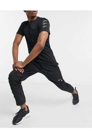 Reebok Training logo joggers in