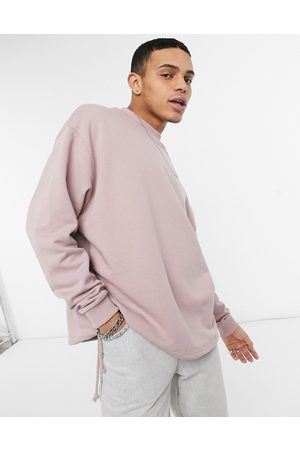 ASOS Oversized sweatshirt with drawcord hem in