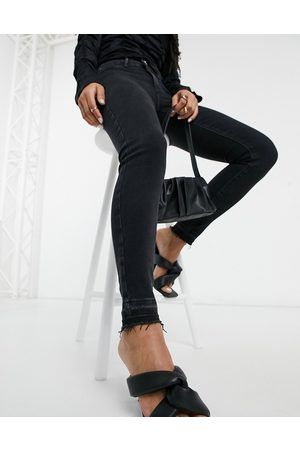 River Island Molly raw hem skinny jeans in washed