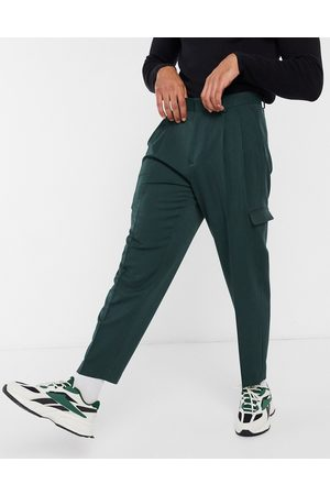 ASOS Oversized tapered smart trousers in dark with cargo pockets