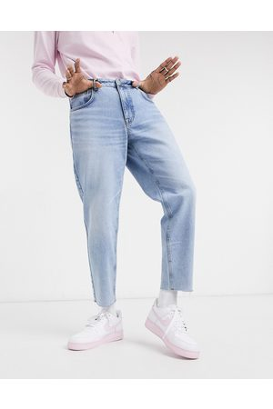 ASOS Classic rigid jeans in vintage light wash with raw hem