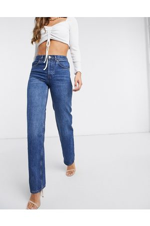 ASOS DESIGN Organic mid rise '90's' straight leg jeans in rich 70's