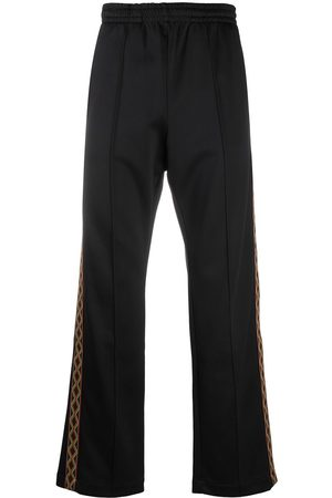 MARCELO BURLON Folk tape panel track pants