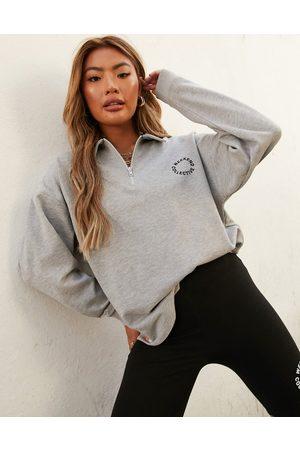 ASOS Women Polo Shirts - ASOS Weekend Collective polo sweatshirt with half zip and logo