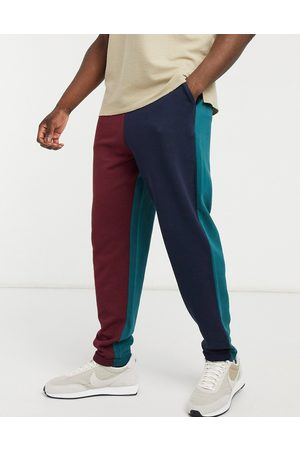 ASOS Oversized joggers in collegiate colour blocking with rolled hem