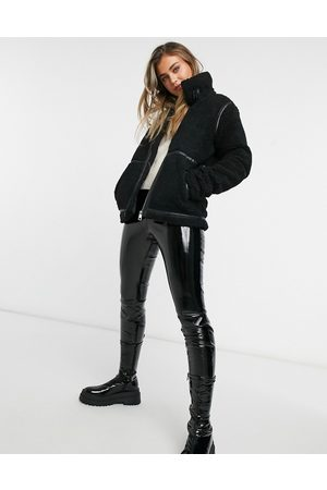JDY Teddy coat with faux leather seam detail in