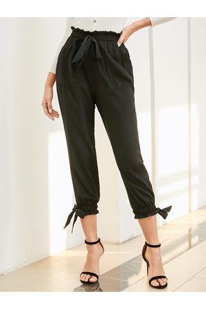 YOINS Black Bowknot Side Pockets Stretch Waistband Pants