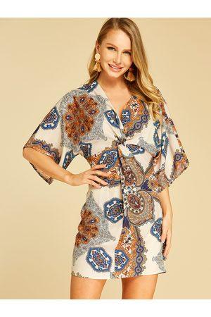 YOINS Apricot Wrap Design Tribal Print Deep V Neck Dress