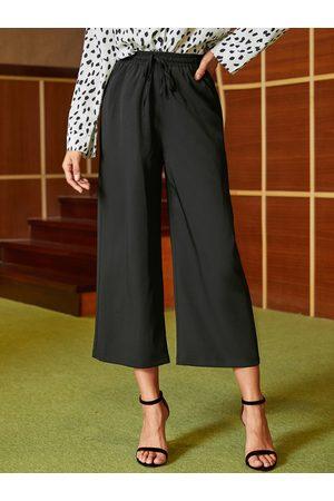 YOINS Black Side Pockets Drawstring Waisted Pants