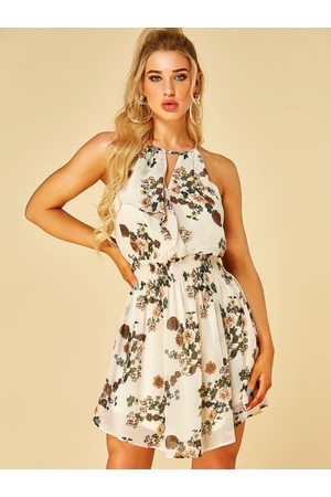 YOINS Apricot Random Floral Print Halter Smocking Waist Dress