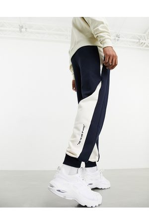 PUMA X Central Saint Martins logo sweatpants in with white detail