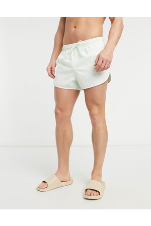 ASOS Runner swim shorts in pastel with white piping