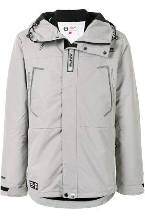AAPE BY *A BATHING APE® Logo print embellished parka coat