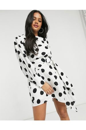 Forever U Belted asymmetric mini dress with elongated cuffs in oversized spot