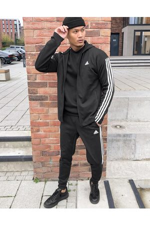 adidas Adidas Training 3 stripe Tiro tracksuit in black