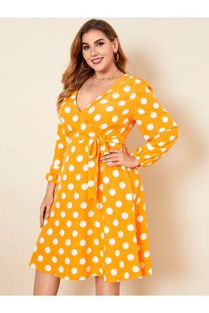 YOINS Plus Size Deep V Neck Polka Dot Wrap Design Long Sleeves Midi Dress