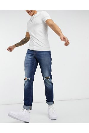 ASOS Men Slim - Stretch slim jeans in dark wash with knee rips