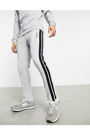 The Couture Club Staight leg side tape velour joggers in