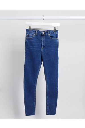 ASOS High rise ridley 'skinny' jeans in bright midwash with raw hem