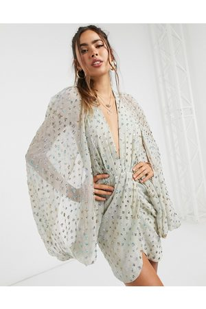 ASOS Sequin embellished cape sleeve mini dress with wrap skirt